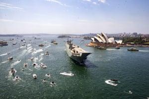 The HMAS Canberra sails on Sydney Harbour on Sunday.