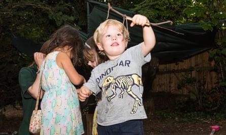 Children enjoying the forest school garden at Cambridge Day Nursery