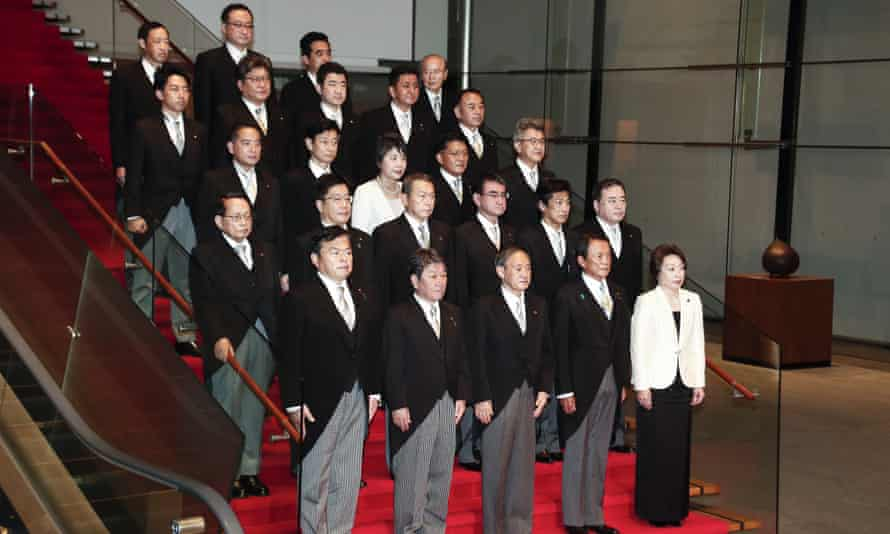 Japan's new prime minister, Yoshihide Suga, (front row centre) poses for a photo with his cabinet members.