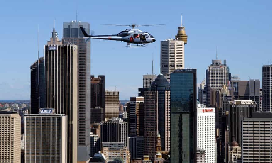 An ABC helicopter flies over Sydney's CBD.