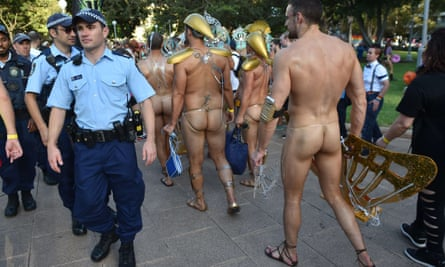 Sydney mardi gras participants walk past police during the 2015 parade.