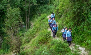 These schoolchildren from Surke must walk for about three miles each way to go to school