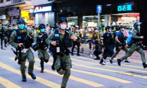 Riot police run towards protesters and disperse them during a rally in Hong Kong against the government's decision to postpone the legislative council elections.