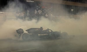 Lewis Hamilton makes donuts after the race