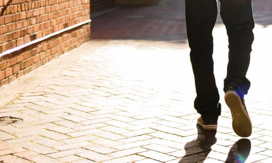 a man walking away.