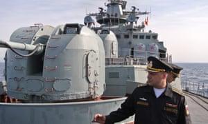 Captain Stanislav Varik, the commander of the Russian navy destroyer Vice Admiral Kulakov, speaks to reporters.