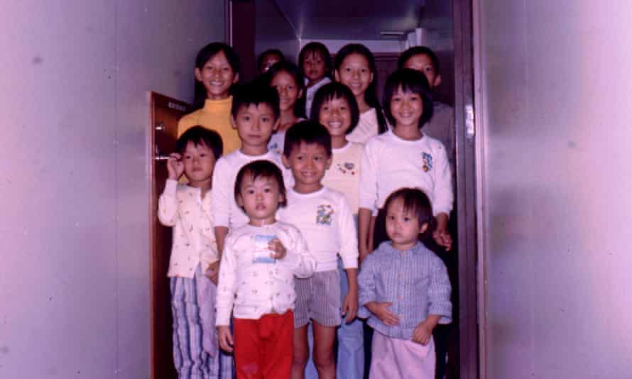 'For us, the crew were heroes': Diep Quan, middle row far right, with her sister. They are pictured on the Wellpark after being rescued.