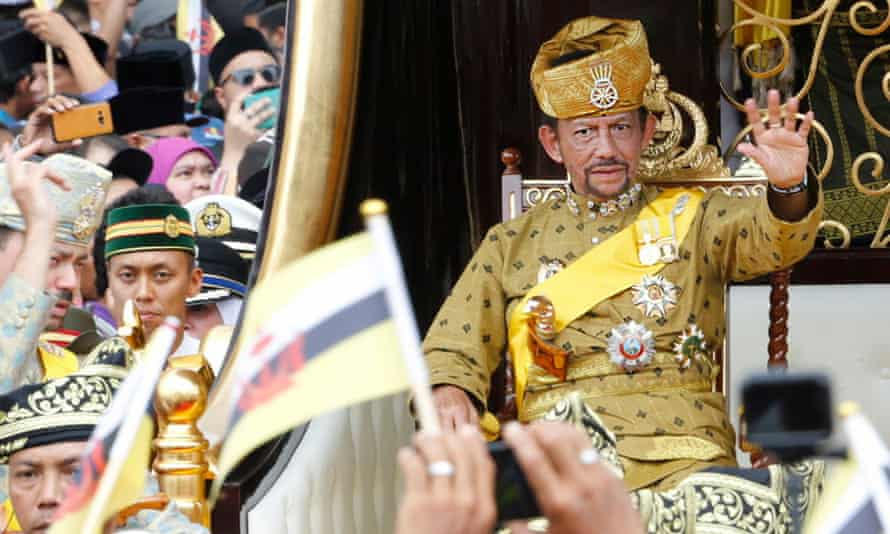 Sultan Hassanal Bolkiah waves to well-wishers during a procession as part of his golden jubilee celebrations in 2017