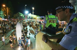The 1% tend to holiday elsewhere … police watch over the Schoolies celebrations.