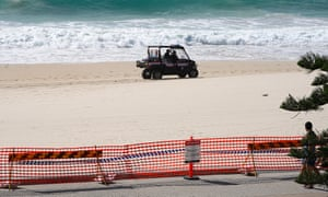 Police patrol Surfers Paradise Beach on Australia's Gold Coast