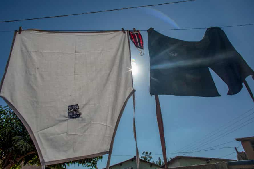 A face mask is seen hang out to dry with work aprons in Glen View 8, Harare.