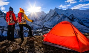 Climbers watch sunrise in Sagarmatha National Park, Nepal. Permits to climb the mountain would only be granted to those who can provide 'proof of competence' under the new plans.