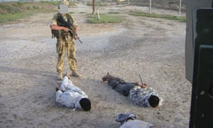 Detained Iraqis being guarded by a British soldier that was shown at the Al-Sweady Inquiry iinto claims that British troops killed and tortured Iraqi civilians.