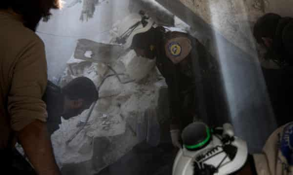 Rescuers search for five children trapped under rubble.
