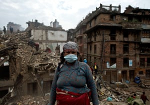 A woman searches for her belongings in Bhaktapur, Nepal