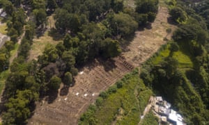 Freshly dug graves are seen at a section where Covid-19 victims are buried at La Verbena cemetery in Guatemala City.
