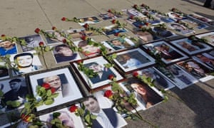 Photographs of missing relatives on the pavement at the Families for Freedom protest at the Syria peace talks in Geneva.