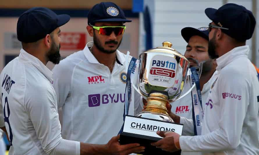 Virat Kohli, Axar Patel, Rishabh Pant and Mohammed Siraj hold the series trophy.