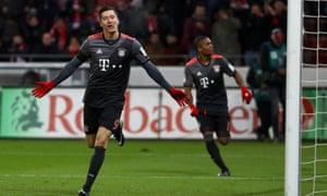 Robert Lewandowski scored twice for the fourth time in four visits to Mainz in helping Bayern Munich back to the top of the Bundesliga.