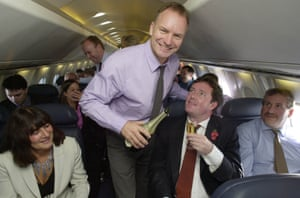 Sting serves champagne to fellow passengers including Piers Morgan as Concorde making its first commercial flight from London to New York after the aircraft were grounded following the crash near Paris in July 2000.