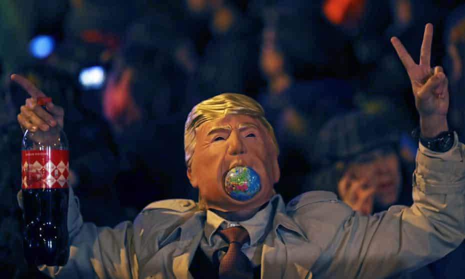 A person wears a Donald Trump mask during the 'March for Climate' demanding action against climate change during the COP25 Climate Summit in Madrid, Spain, in December 2019.