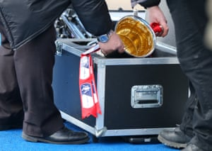 The FA Cup trophy is placed into its protective case