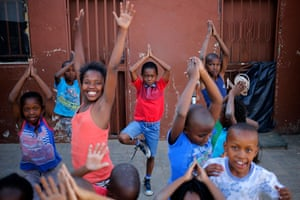 Some children who watched Sindiso Moyo have fun trying to emulate his yoga poses