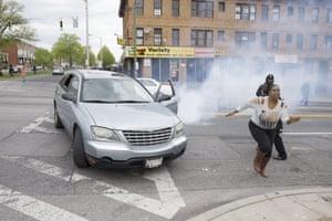 Woman flees vehicle teargas
