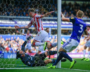 Liam Lindsay of Stoke City bundles in the opening goal in the 58th minute.