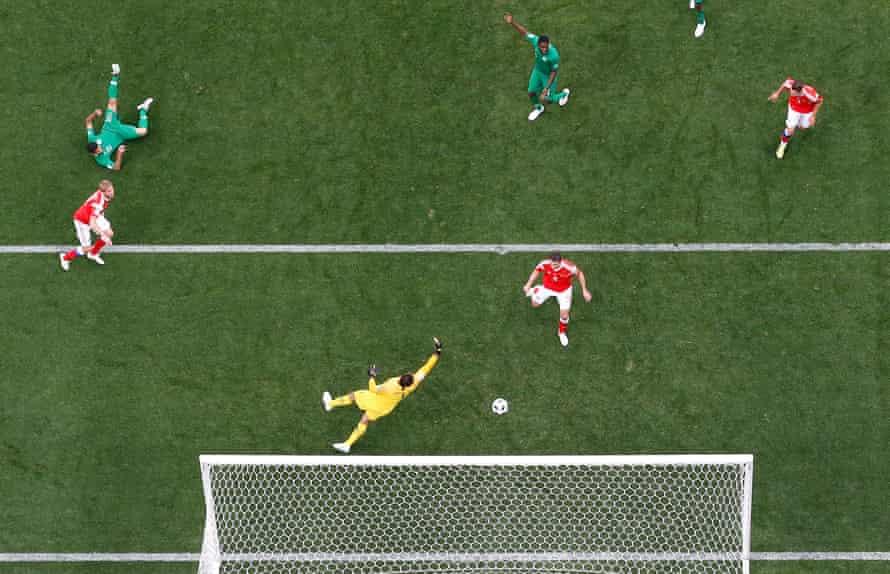 Yury Gazinsky, left, scores the opening goal.