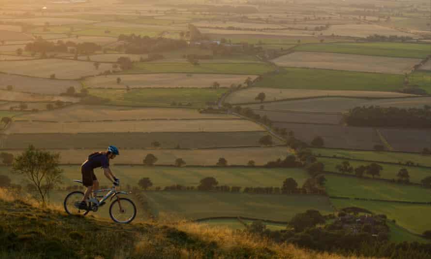 Mountain biker riding down a hill.Shropshire, UK