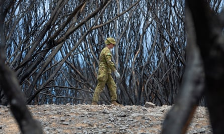 An Australian army trooper in the process of removing deceased wildlife from the Hanson wildlife sanctuary on Kangaroo Island