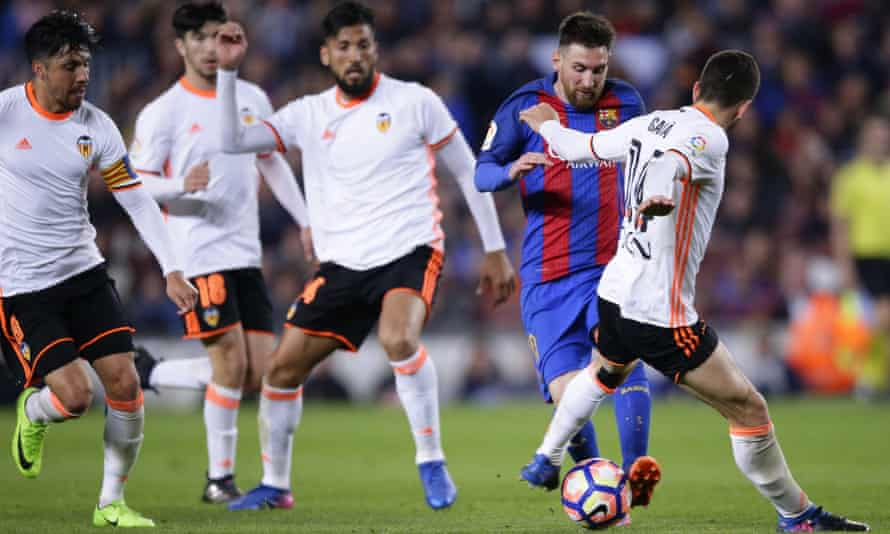 Barcelona's Lionel Messi weaves through the Valencia defence during the 4-2 win on Sunday.