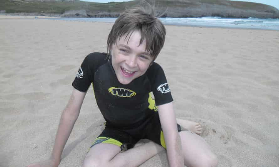 'You don't get kisses, Mummy, you don't get hugs.' Jack Cavanagh, on a beach in his younger days, has autism, a learning disability and epilepsy, and lives in secure care in south Wales.