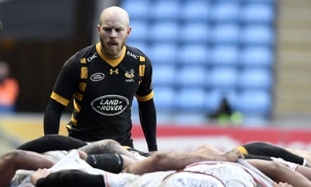 Wasps' Joe Simpson stands over the scrum.