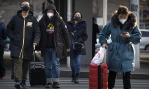 people wearing masks with suitcases