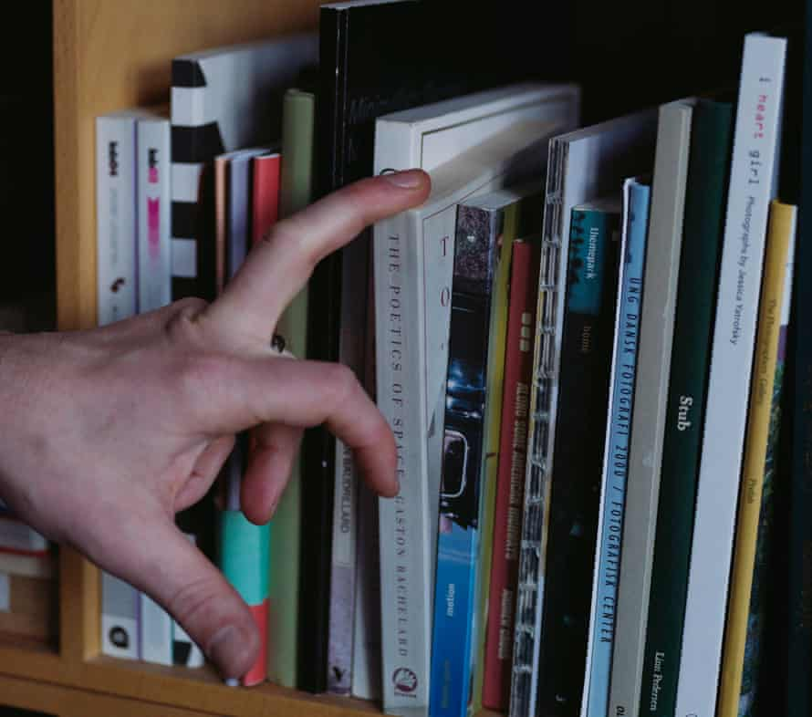 Checking the book cases for book lice. Photograph: Marie Hald/The Guardian
