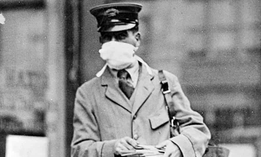A New York mail worker wearing a mask designed to stop infection during the 1918 Spanish flue outbreak.