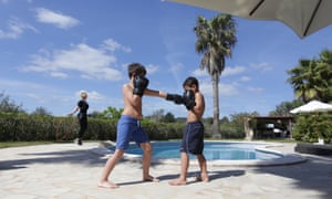 Brotherly love … Decca Aitkenhead's boys do so some sparring while she skips by the pool at Casa Tekne.