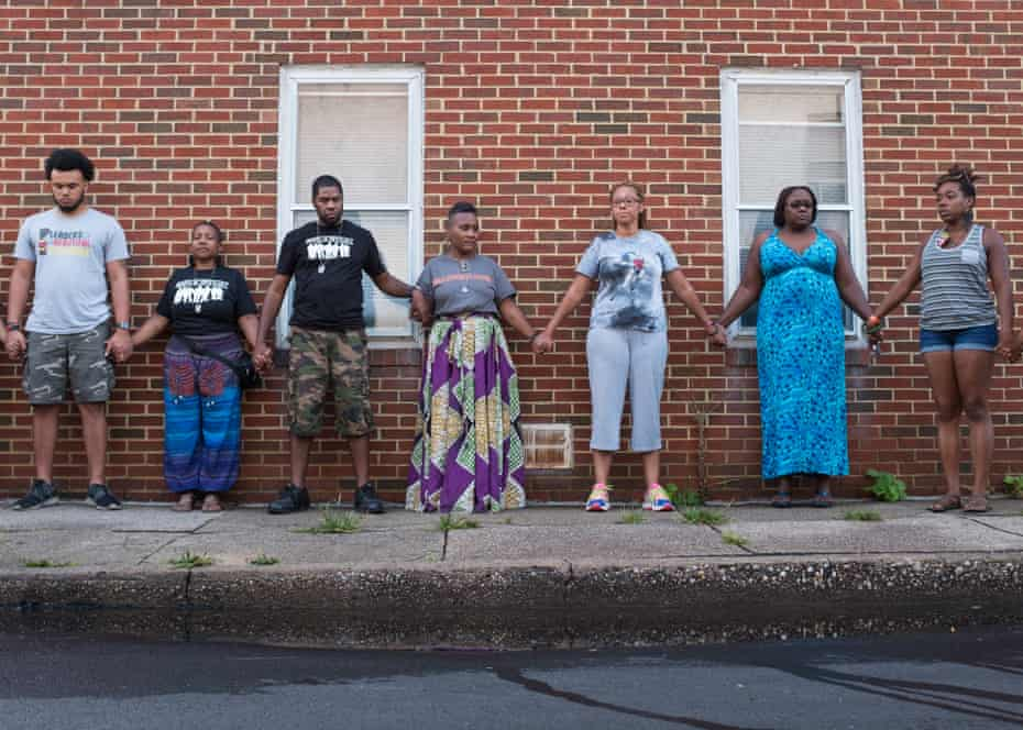 Erricka Bridgeford in line-up against wall with other participants of the Ceasefire.