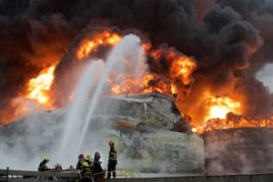 <strong>Zhangzhou, China</strong><br>Firefighters try to extinguish a fire at the site of a chemical plant blast. A xylene facility leaked oil and caught fire, which led to blasts and a fire at three nearby oil storage tanks at Tenglong Aromatic Hydrocarbon (Zhangzhou) Co. Ltd. Six people were injured in the plant blast
