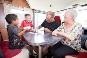 French spectators play card game la Bataille inside their camper