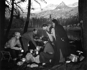 Yosemite 1938 – On The Trail with Ansel Adams and Georgis O'Keeffe which runs from 10 June to 28 August. Around the campfire at Yosemite national park are, from left: David McAlpin, the camp cook, Helen and Godfrey Rockefeller, and Georgia O'Keeffe