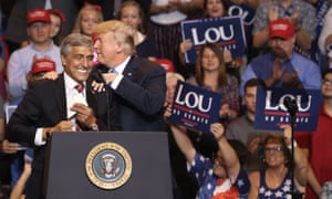 Senate candidate Lou Barletta gets a shoulder squeeze from President Donald Trump on August 2, 2018 in Wilkes-Barre, Pennsylvania.