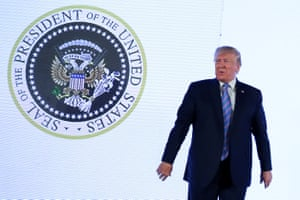 Trump stood in front of the image, which was doctored to resemble Russia's coat of arms with added golf clubs, for about 80 seconds this week.