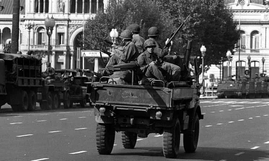 Army soldiers patrol the Buenos Aires Plaza de Mayo on March 24, 1976 after the military coup that overthrew President Peron.