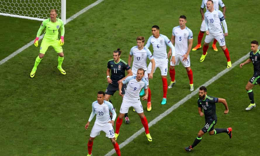 England players defend a free-kick during the group match at Lens, where Wales led 1-0 but lost 2-1