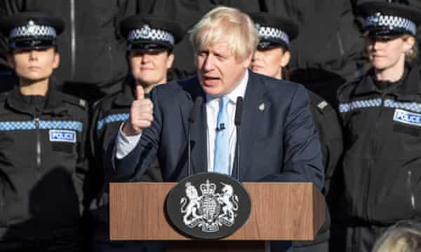 Boris Johnson in West Yorkshire in 2019, at the launch of a drive for more full-time police