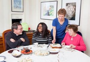 Grace, 36, from Malawi with hosts Len, Karen, and Karen's mum Violet enjoying afternoon tea