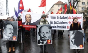A procession of leftwing radicals march to Friedrichsfelde cemetery in Berlin to commemorate the 100th anniversary of the murder of Rosa Luxemburg and Karl Liebknecht